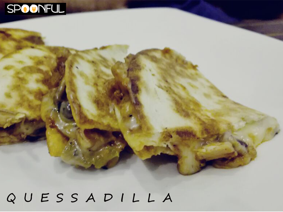Yes, that is cheese oozing out of the Quesadilla